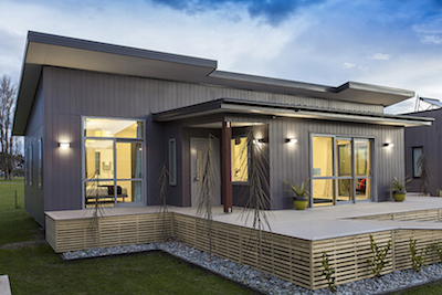 The ekohome show home in Christchurch is a timber house, built on piles.