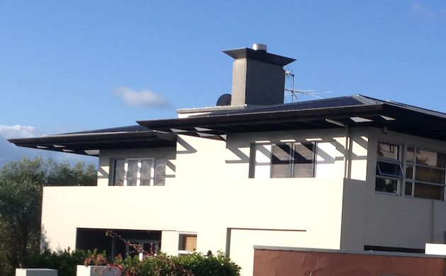 This modern house has good sized eaves that are providing some shading, even late in the afternoon.