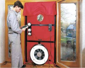 A blower door consists of a fan, a cover the for the door, and a pressure gauge. (Oh, and a cool looking guy with a parachute suit and a clipboard)